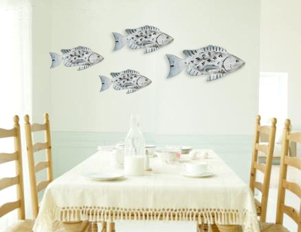 accent wall decor idea with fish sculptures