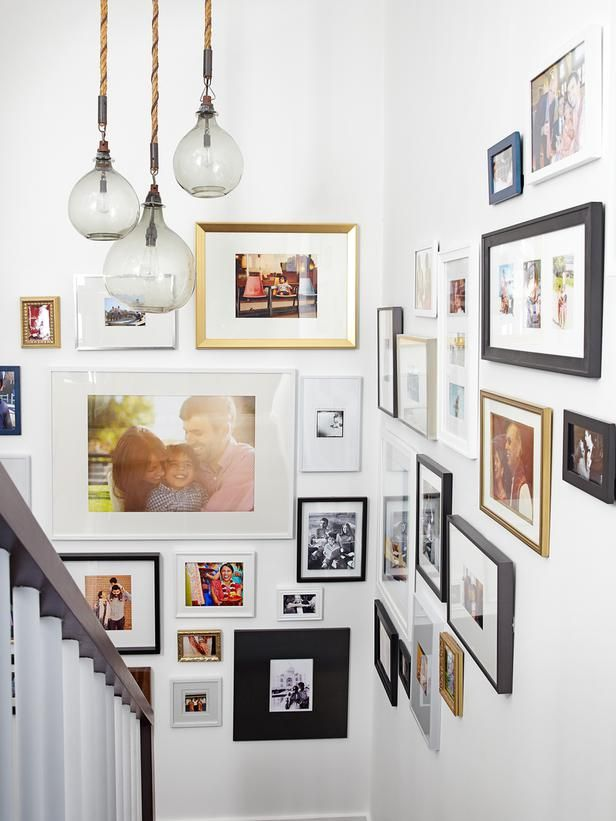 great gallery wall of pics in staircase