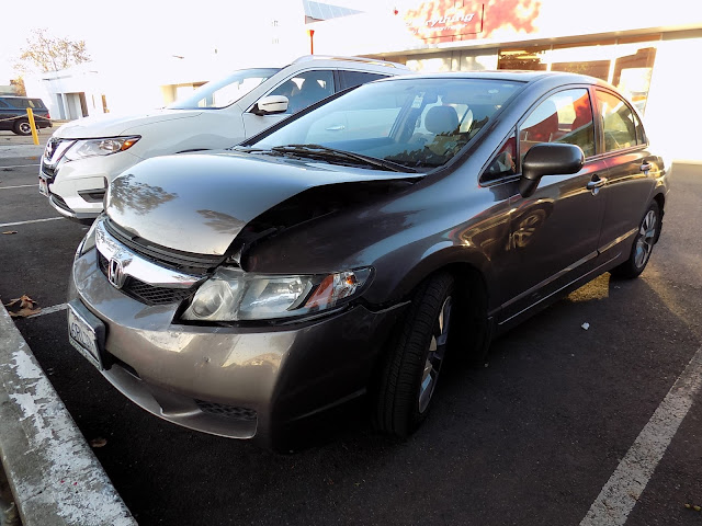 Honda Civic with damaged hood, bumper & fender before repairs at Almost Everything Auto Body.