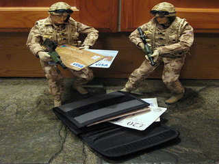Photo of two toy soldiers and credit cards.
