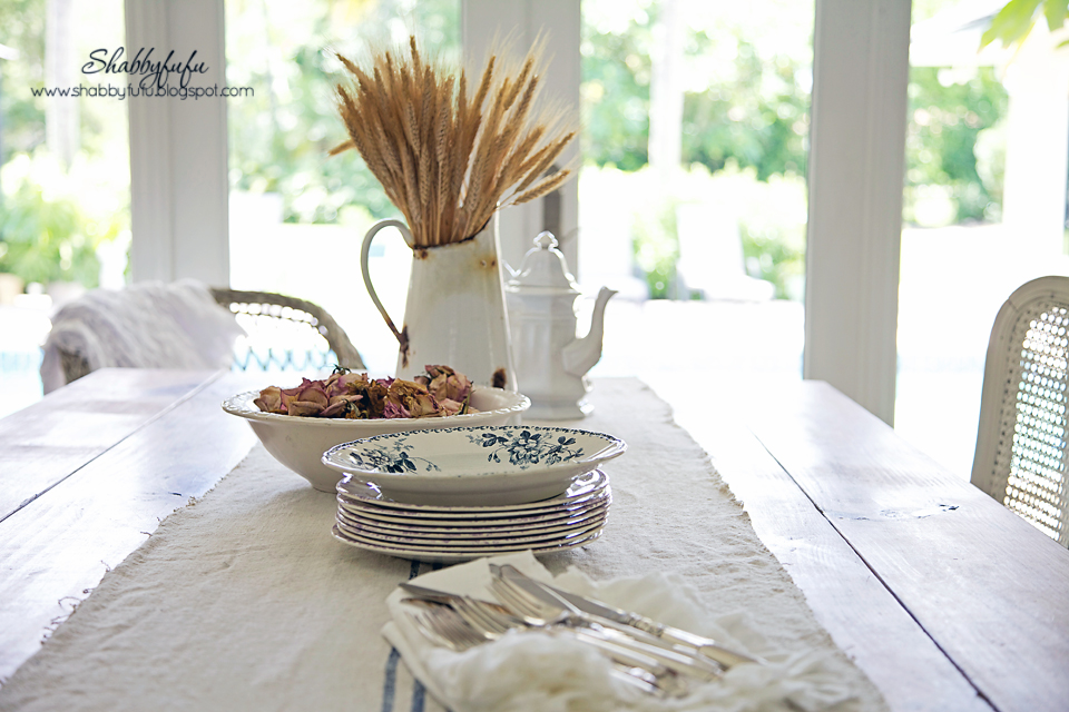 Perfect your fall vignettes with seasonal centerpieces on your dining room table - this centerpiece is complete with dried wheat stalks.