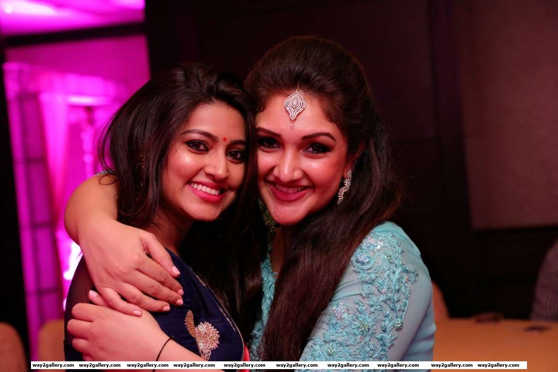 Sneha and Sridevi Vijaykumar pose for photographers during the latters daughters naming ceremony