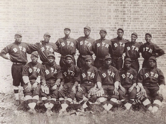 "Based in Holden, MO, this Barnstorming Black Baseball team & Minstrel Show traveled the Midwest winning games and hearts with their talented entourage. Phil S. Dixon continues to find and share more about this popular, but largely unknown team of the early 1900s. Browns Tennessee Rats Baseball team 1914, Holden, Missouri. Norman P. Little, 3rd from Left, Front Row, great-grandfather to Aurelia Little Thomas-Ray, from Warrensburg, MO William (Bill) ""Plunk"" Drake 4th from left, back row."