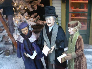 The carollers are signing what a wonderful evening!
