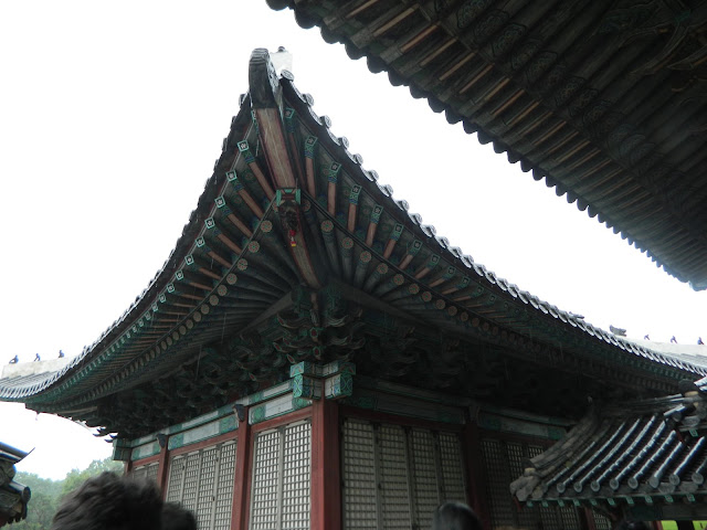 Graceful inclines of the palace roofs