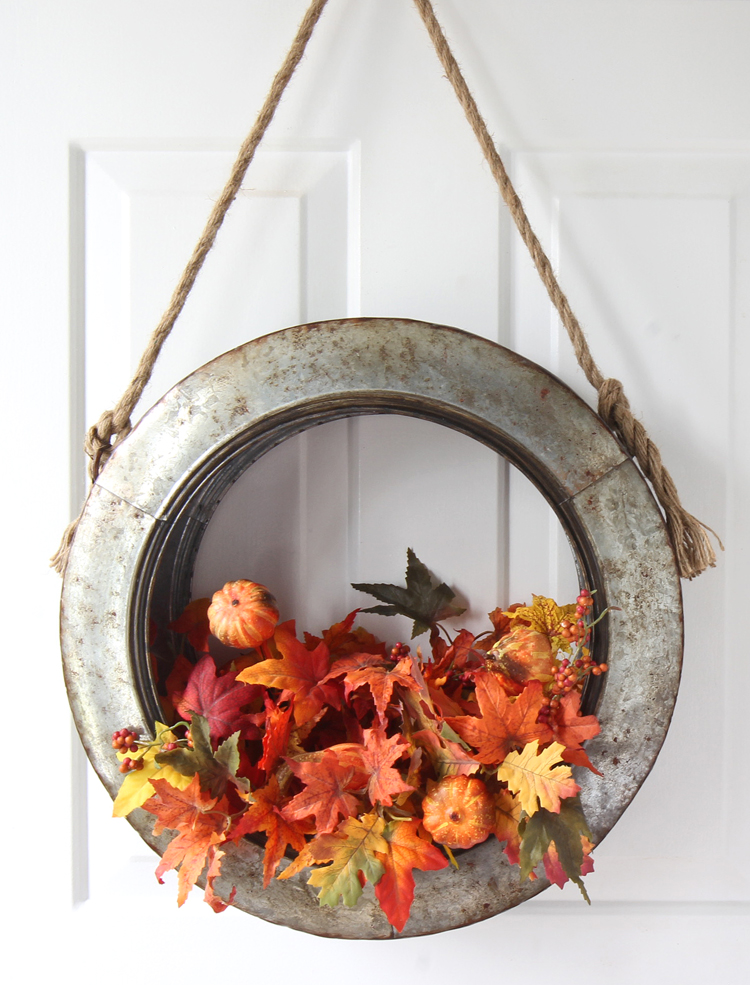 Turn a decorative galvanized metal tire into a stunning fall decor piece