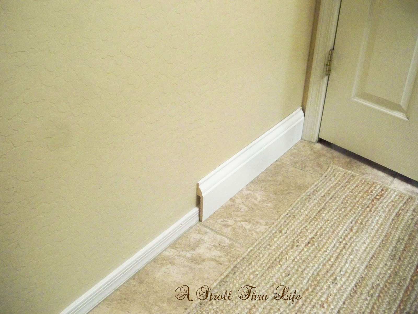 a stroll thru life: install wide baseboard molding over existing