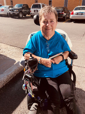 portrait of Sharon in her wheelchair