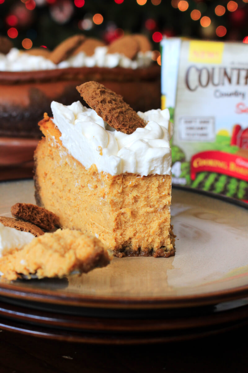 This Pumpkin Cheesecake with Gingersnap Crust is rich, festive, comforting and the perfect dessert for holiday celebrations!  #sponsored #cheesecake #pumpkin #whenwebake