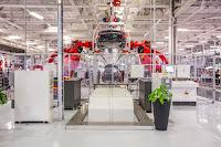 Robots at the Tesla factory in Fremont, Calif. put together electric cars. (Credit: Tesla Motors) Click to Enlarge.