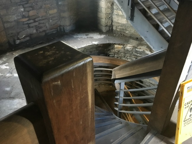 a-toddler-explores-cardiff-castle-world-war-two-shelters-view-of-inside-castle-spiral-stairs-leading-to-battlements