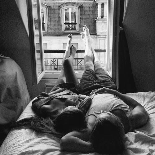 They are lying on bed pretty close to each other the window is wide open if they kiss or make love or simply cuddle the world will sit back and watch