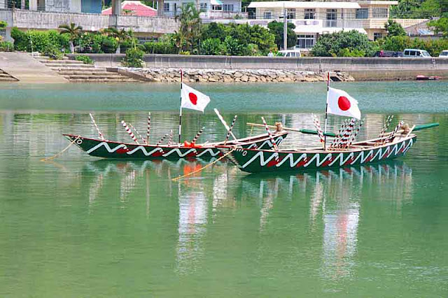 sabani boats, Japanese flags, oars, reflecting in water