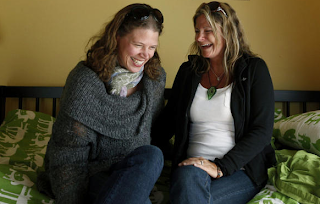 Image: Erin, left, is shown with high school friend Shelagh McKee, who is carrying the child of Erin and her husband, Jason. The baby girl is due in early August. Charla Jones for the Toronto Star