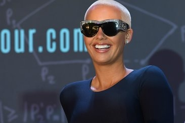 amber rose stopped dj not playing iz Khalifa and Kanye West music