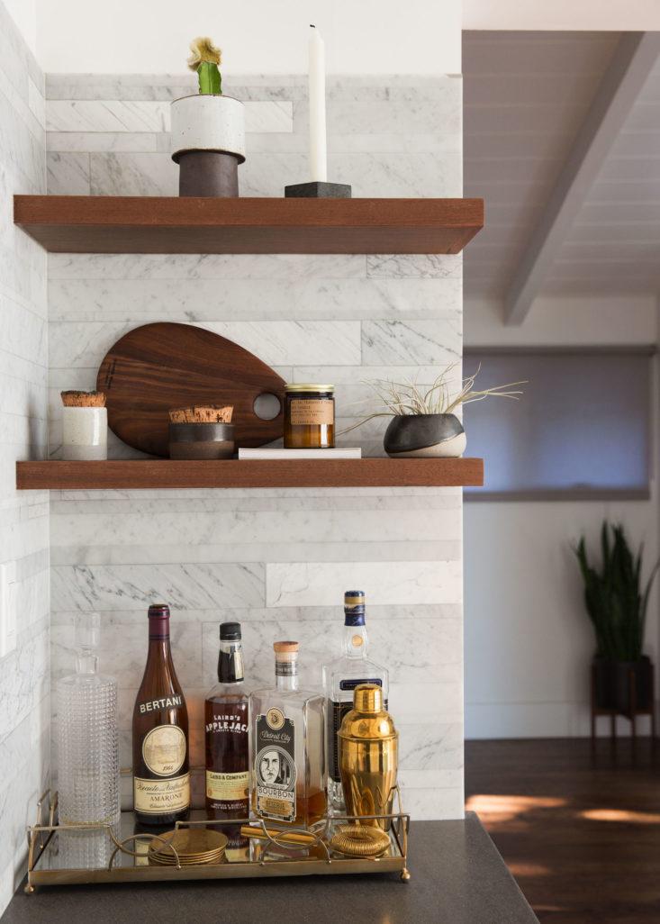 Bar area marble backsplash in minimal modern Brendon Urie kitchen