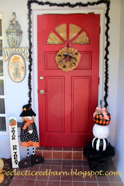 Eclectic Red Barn: Front door decorated for Halloween with stacked pumpkins