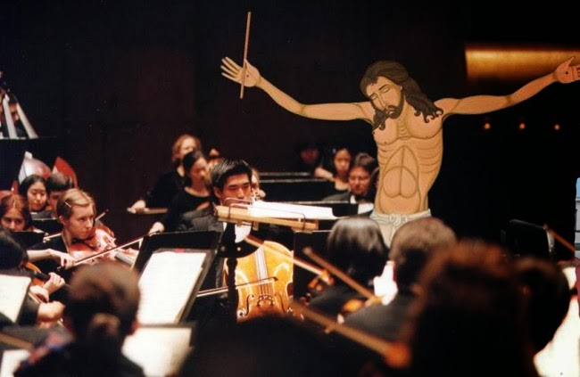Funny Crucified Jesus Poses - conducting an orchestra