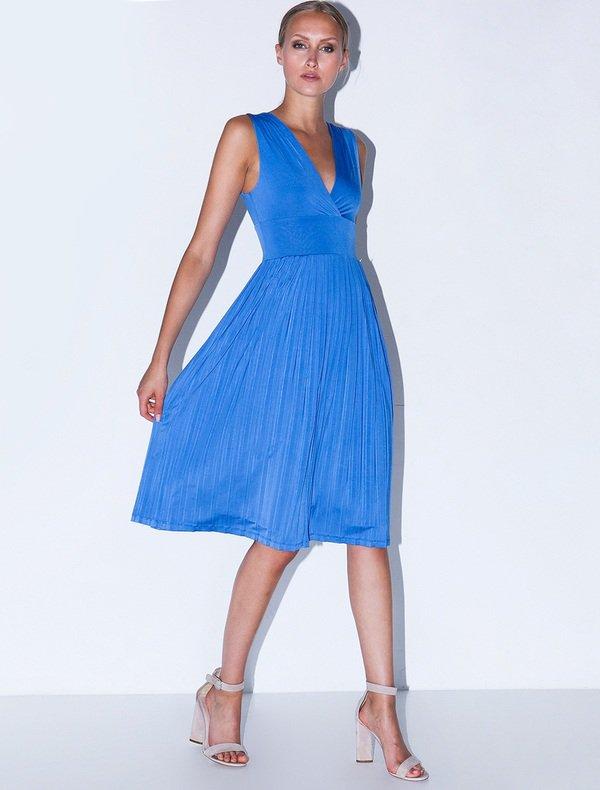 806f1d67e55e Αμάνικο μίντι φόρεμα με πλισέ φούστα και V-λαιμό πλάτη.