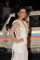 Surveen Chawla In White Dress Pos2.jpg