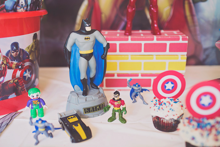 superhero action figures used to decorate birthday party dessert table