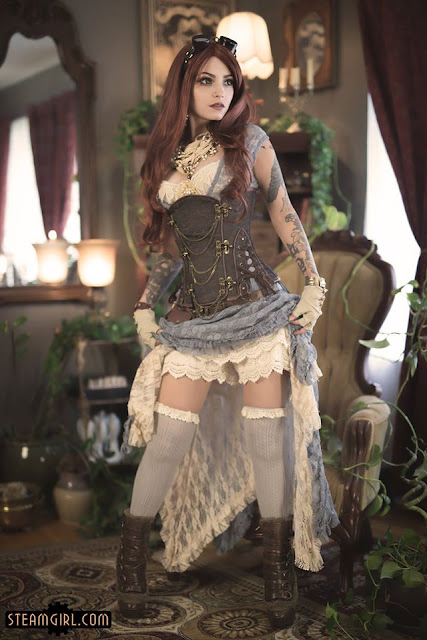 Steampunk Burlesque performer wearing a lace dress and showing her lace knickers/bloomers/shorts. sexy steampunk burlesque fashion