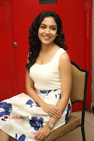 Actress Ritu Varma Stills in White Floral Short Dress at Kesava Movie Success Meet .COM 0170.JPG