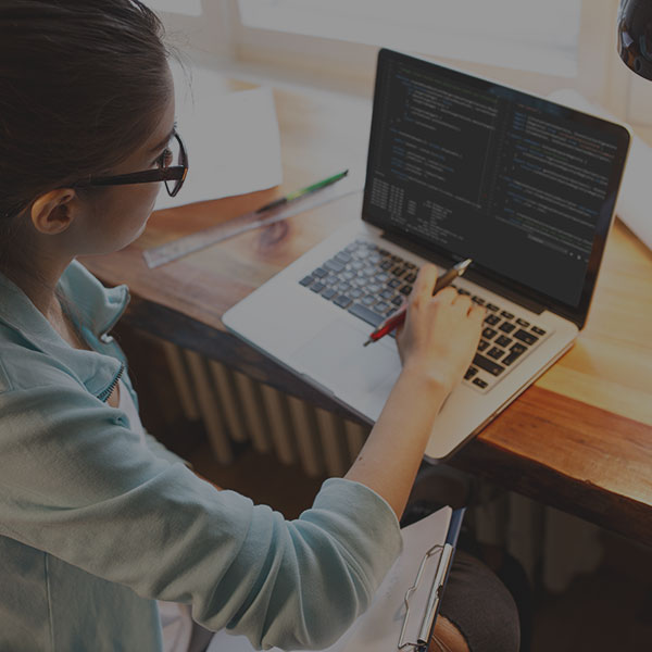 Female programmer working at home
