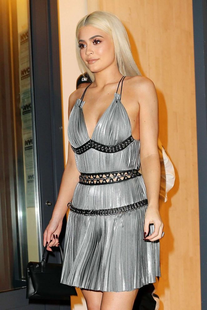 Kylie Jenner dazzles in metallic pleated dress at the Alexander Wang NYFW Fashion Show