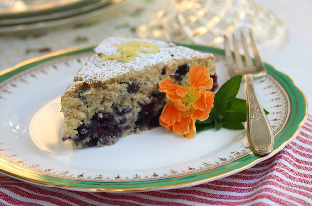 A simple blueberry cake made with whole wheat pastry flour is a delicious end-of-summer dessert. Wonderfule made with frozen blueberries too...