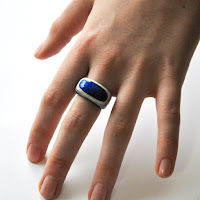 layered paper ring shown on hand