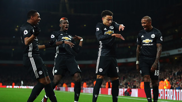 Anthony Martial, Paul Poba, Ashley Young watch Jess Lingard dance as he celebrates his goal at the emirates against Arsenal
