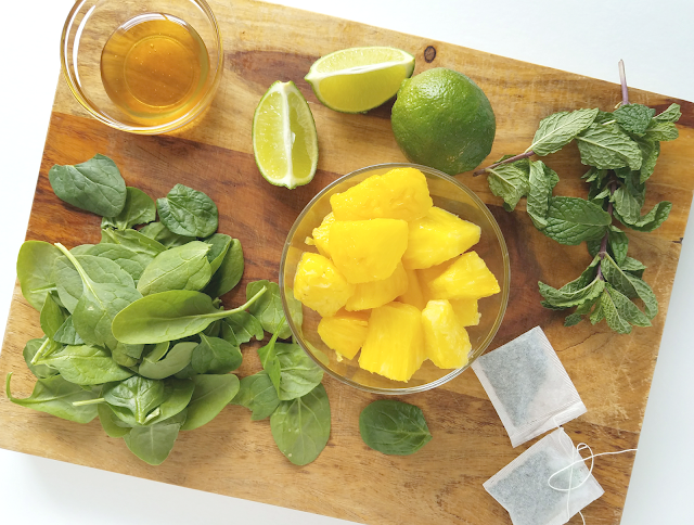 This gluten-free, dairy-free, nut-free, paleo and vegan smoothie contains pineapple, spinach, fresh mint, green tea, coconut milk, honey and lime juice.