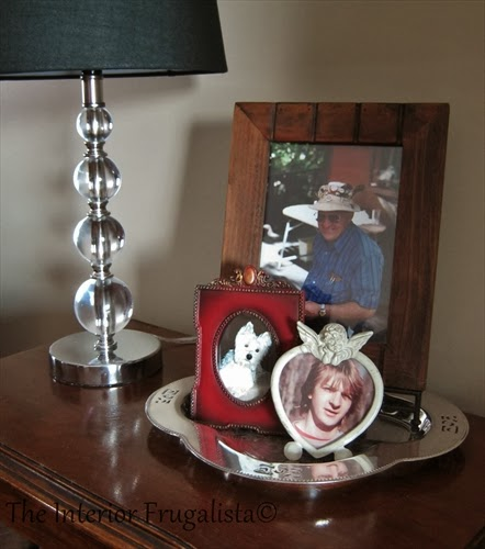 Silver clover shaped plate used for displaying photographs