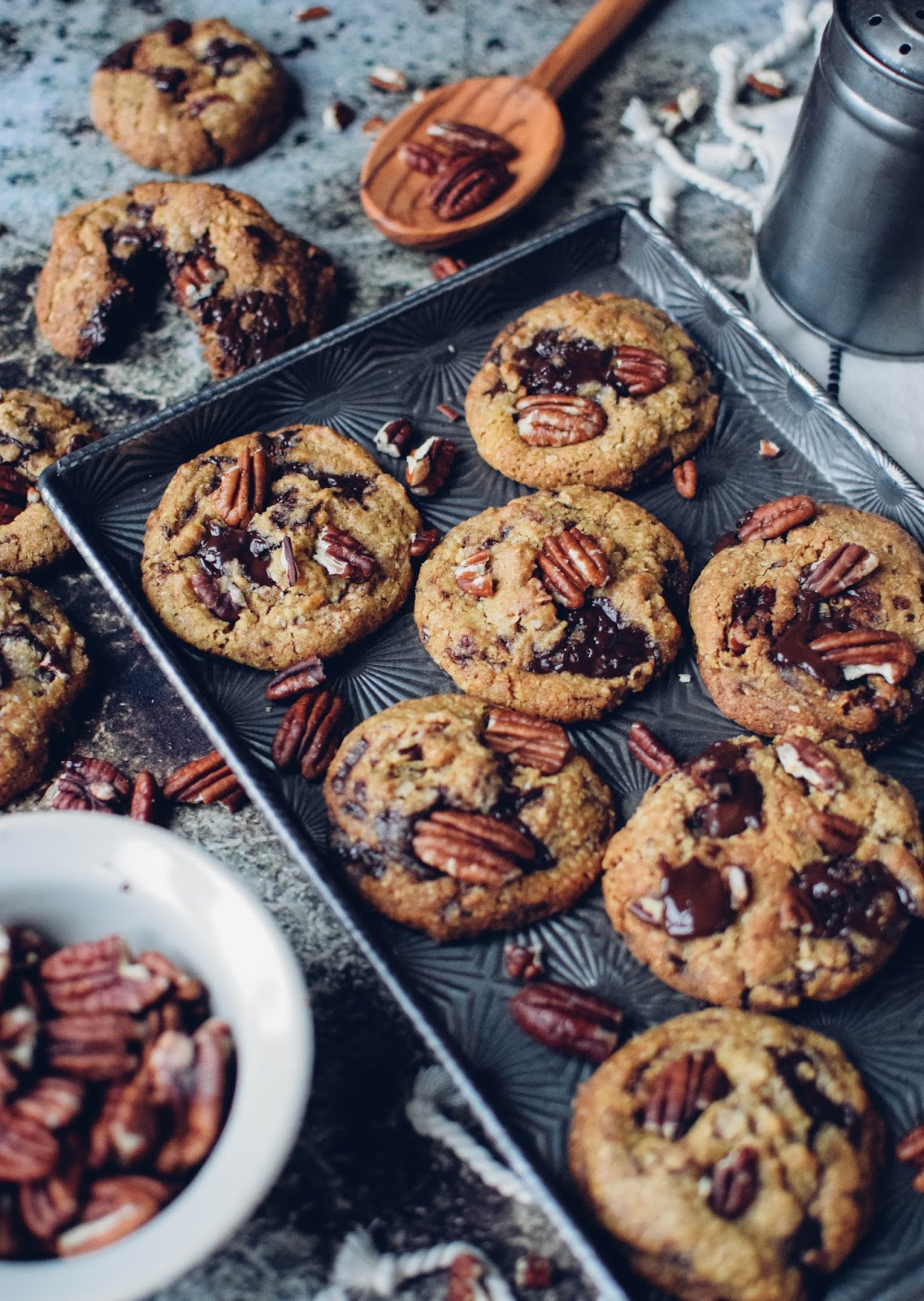 These chocolate chip cookies use ground pecans and coconut in the flour mixture and the darkest chocolate to give them a deep, sophisticated taste, this is a cookie for the adults. No kids allowed. Unless they've been really good...