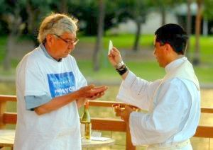 Image result for tony martinez, brownsville. taking communion