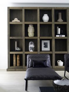 Modern luxury shelves with art minimal sophisticated interior design by Piet Boon