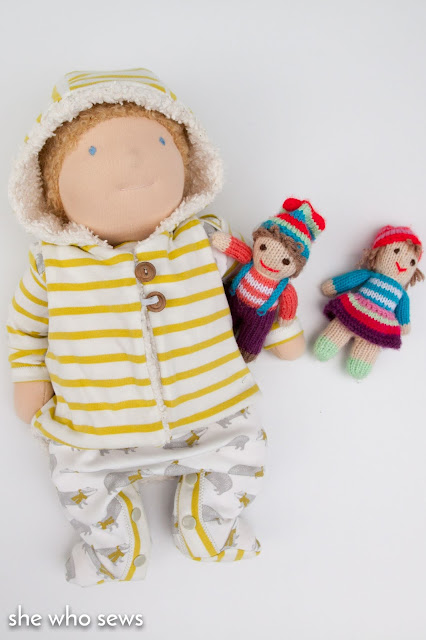 Baby doll with knitted dolls