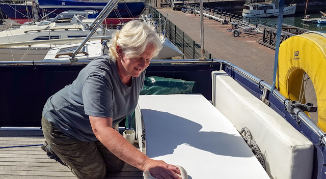Photo of polishing one of the aft deck lockers in the sunshine