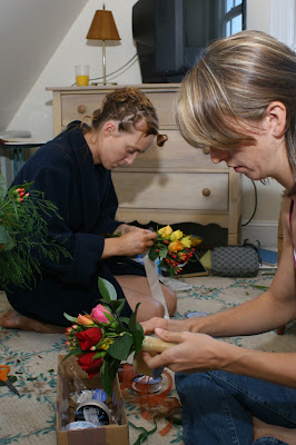 bride and bridesmaking making bouquets