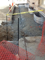 Water main trench and lower level windows