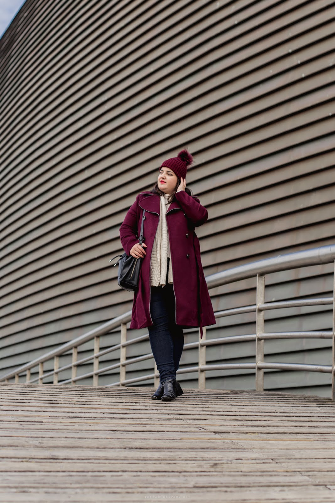 A burgundy winter coat and beanie making up for the perfect Winter outfit. All about fashion, style and comfort.