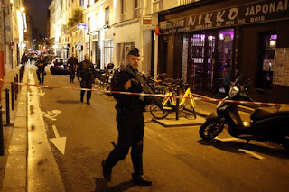 Parents of Paris attacker held by police