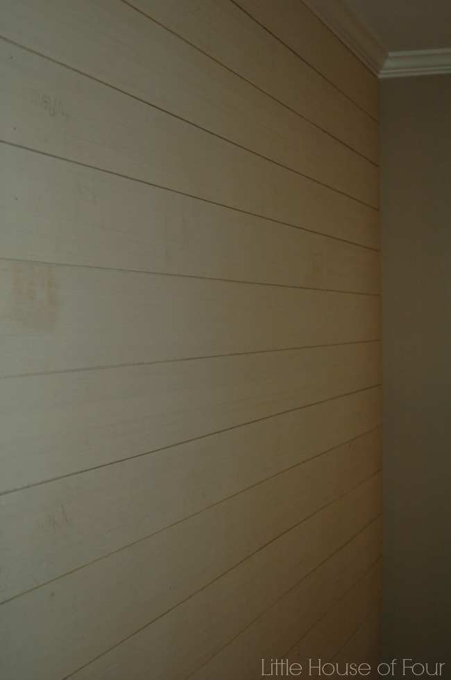 installed wood planks for DIY plank wall