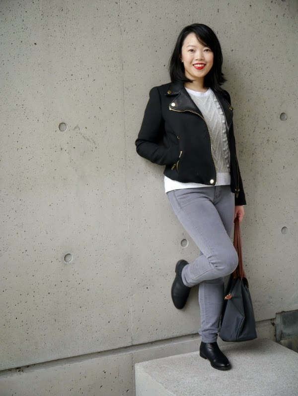 Monochromatic in a moto jacket and cable knit pom pom sweatshirt
