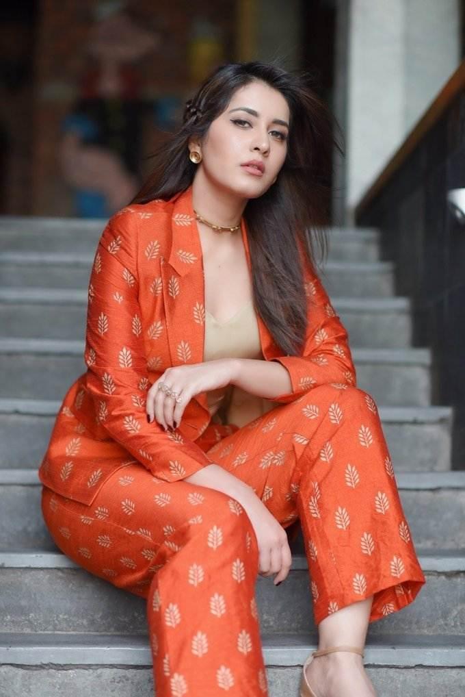 Raashi Khanna latest Photo Shoot Stills In Long Hair Orange Dress