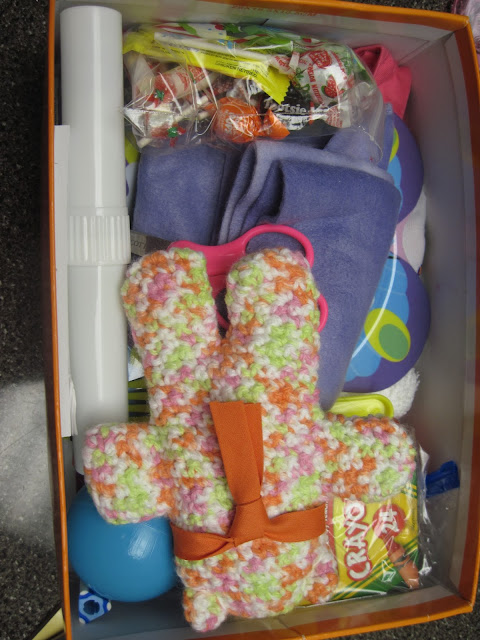 Teddy bear added to Operation Christmas Child shoebox for 2 to 4 year old girl.