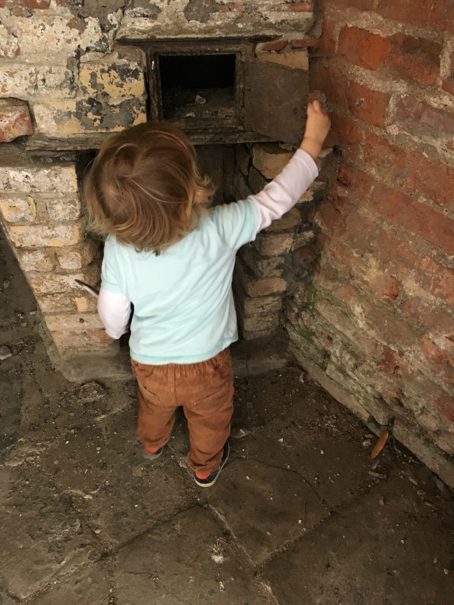 toddler-exploring-little-oven