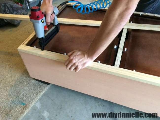 Adding a wood frame around the top of the coffee table.