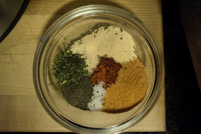 All of the seasonings combined in a bowl.